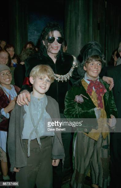 American singer Michael Jackson poses with cast members at a performance of the musical 'Oliver' at the Palladium Theatre London 4th October 1996