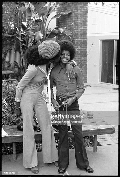 American singer Michael Jackson receives a kiss from a visiting journalist at his home Los Angeles 28th November 1972 Taken during a photoshoot for...