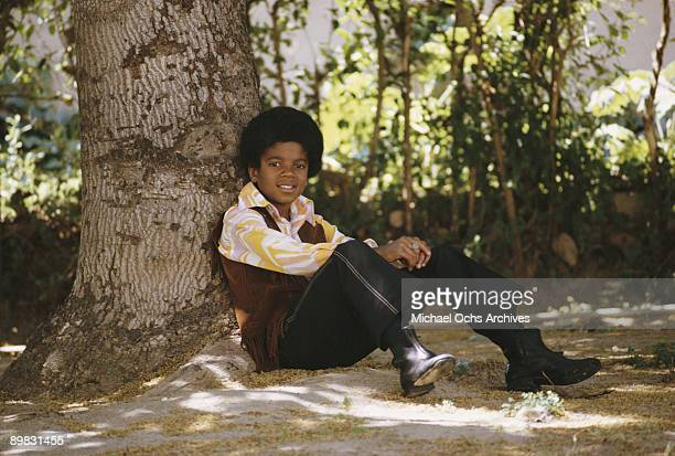 American singer Michael Jackson relaxes under a tree April 1970