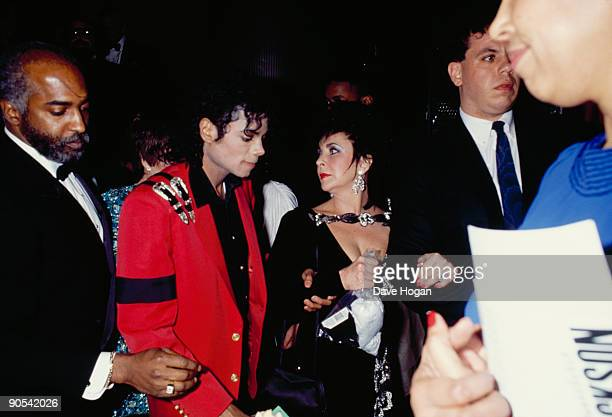American singer Michael Jackson with actress Elizabeth Taylor at at the United Negro College Fund dinner, New York City, 10th March 1988.