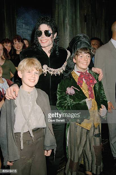 American singer Michael Jackson with cast members at a performance of the musical 'Oliver' at the Palladium Theatre London 4th October 1996
