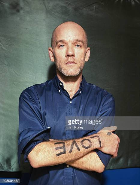 American singer Michael Stipe of REM with the word 'Love' printed on his arm circa 2000