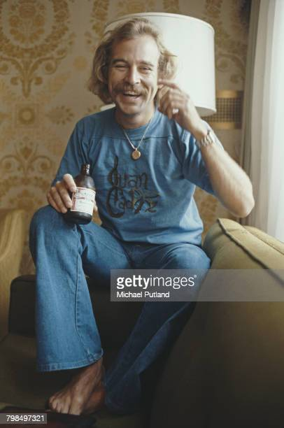 American singer, musician and songwriter Jimmy Buffett pictured holding a bottle of Budweiser beer during an interview in New York, USA, 3rd August...