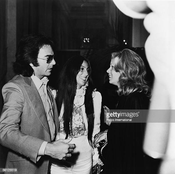 American singer Neil Diamond his second wife television producer Marcia Murphey and entertainer Cher attend an American Civil Liberties Union tribute...