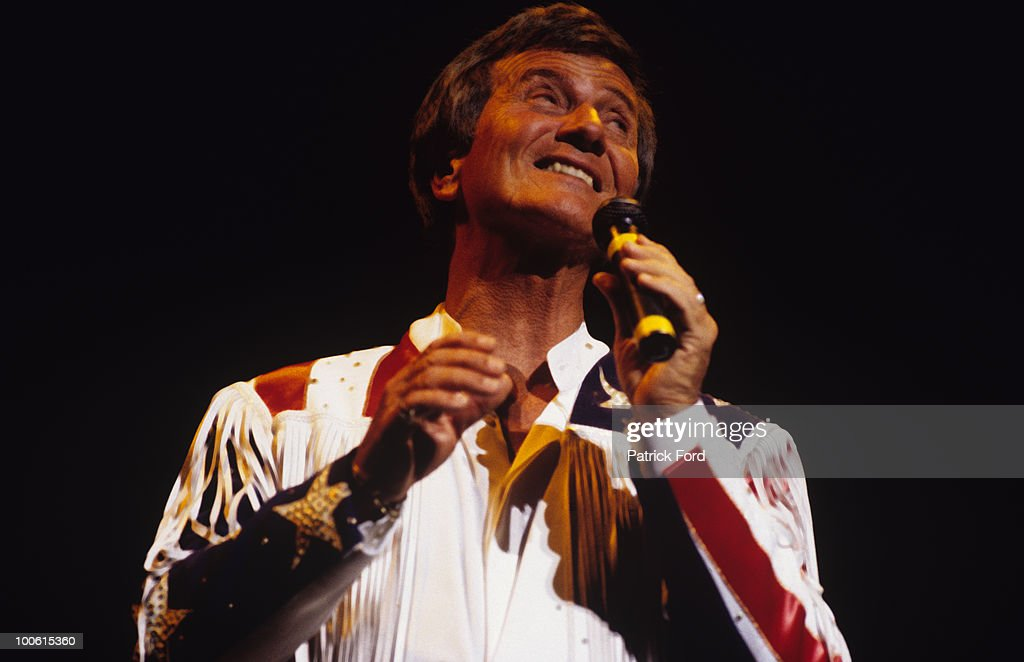 American singer Pat Boone performs on stage in 1995.