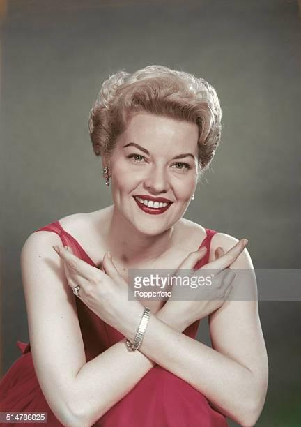 American singer Patti Page posed wearing a pink dress circa 1950