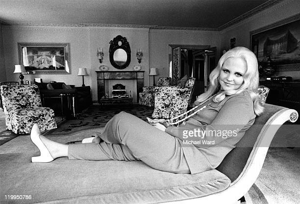 American singer Peggy Lee relcining on a chaise longue before a Royal Albert Hall concert 1970