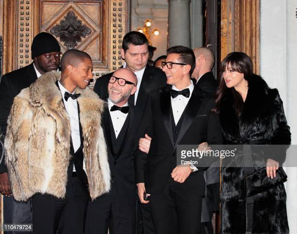 American singer Pharrell Williams Domenico Dolce Stefano Gabbana and Italian actress Monica Bellucci leave the Italian Embassy in Moscow after...