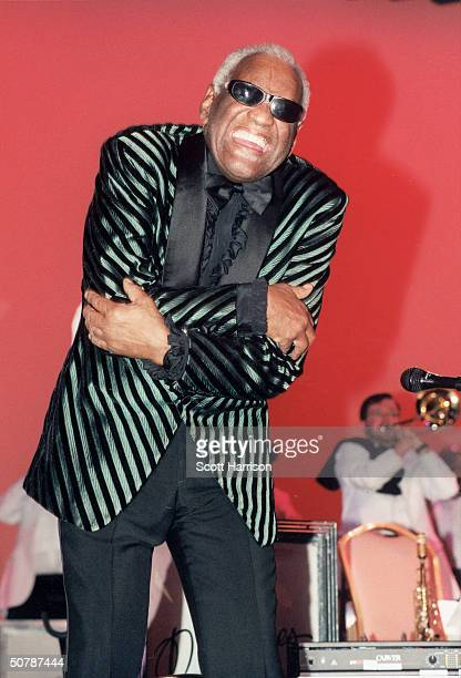 American singer pianist and songwriter Ray Charles folds his arms as he performs in a concert at the Orleans Hotel and Casino Las Vegas Nevada...