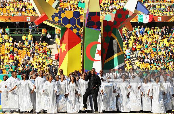 American singer R Kelly performs with the Soweto Spiritual singers during the Opening Ceremony ahead of the 2010 FIFA World Cup South Africa Group A...