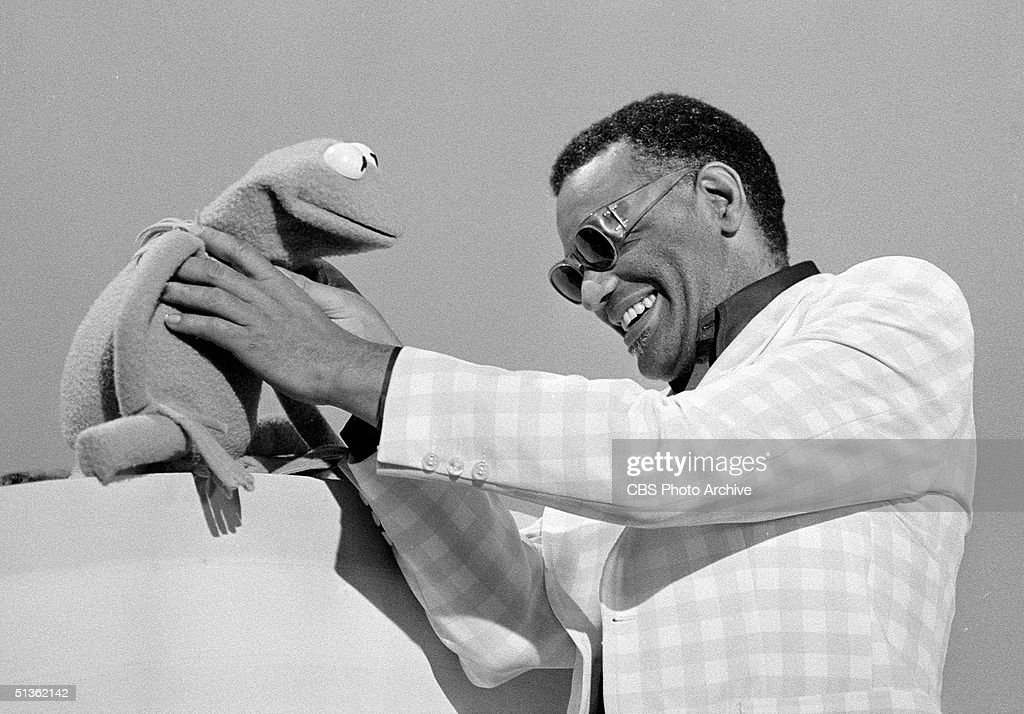 American singer Ray Charles (1930 - 2004) gets a better understanding of Kermit The Frog in a still from the musical/variety program 'Cher,' Los Angeles, California, August 7, 1975.