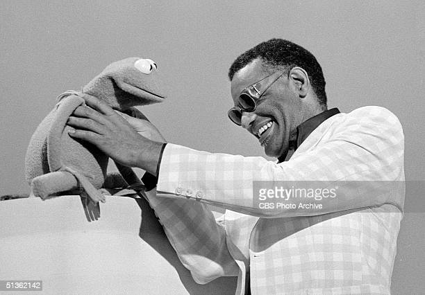 American singer Ray Charles gets a better understanding of Kermit The Frog in a still from the musical/variety program 'Cher' Los Angeles California...