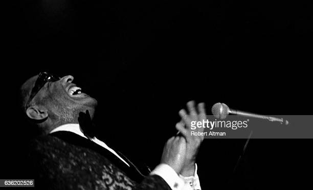 American singer Ray Charles laughs behind his piano during a concert on December 5 1971 in San Francisco California