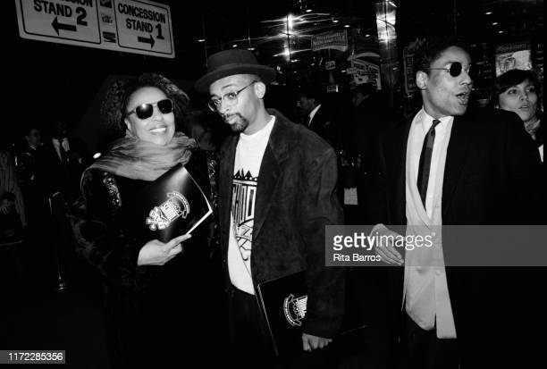 American singer Roberta Flack and film director Spike Lee pose together beside actor Giancarlo Esposito at the Criterion cinema during the preview of...