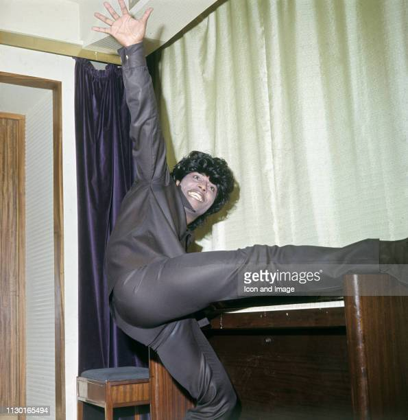 American singer, songwriter, actor and recording artist Little Richard poses on the piano while touring Europe, November 1966, in London, England.