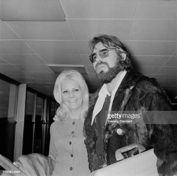 American singer songwriter actor record producer and entrepreneur Kenny Rogers with his wife Margo Anderson at Heathrow Airport London UK 24th March...