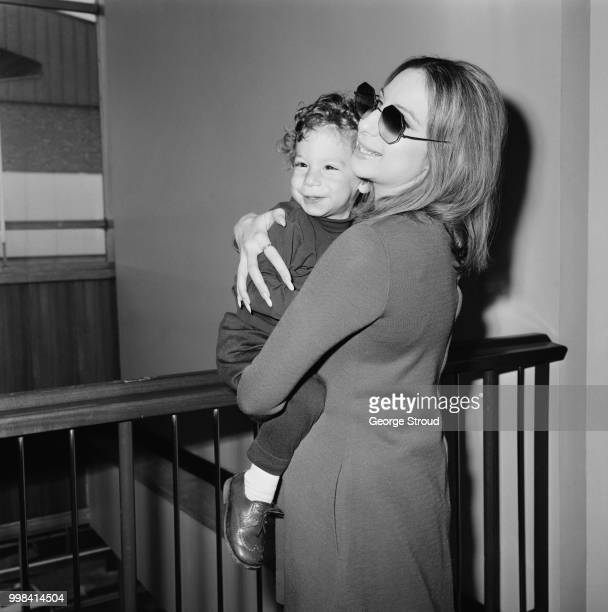 American singer songwriter actress and filmmaker Barbra Streisand with her son Jason Gould at Heathrow Airport London UK 11th April 1969