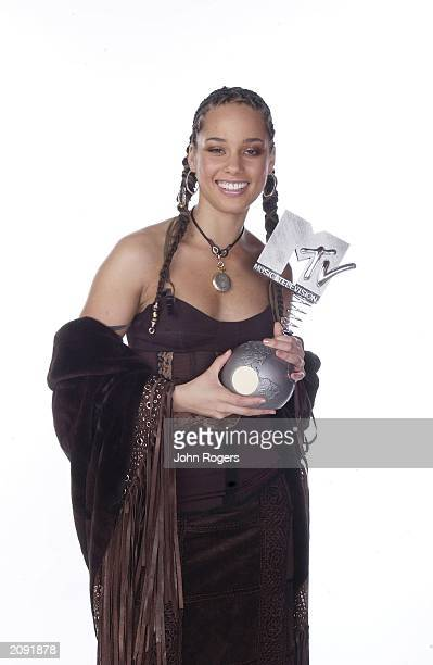 American singer songwriter Alicia Keys poses for an exclusive studio portrait at the 2002 MTV Europe Music Awards in Barcelona Spain on November 16...