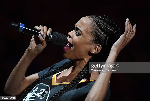 American singer songwriter and actor Michelle Williams sings the National Anthem prior to Game One of the Western Conference Quarterfinals 2016 NBA...