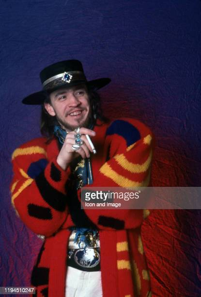 American singer songwriter and bluesrock guitar great Stevie Ray Vaughan poses backstage at the Royal Oak Music Theater during his Soul to Soul world...