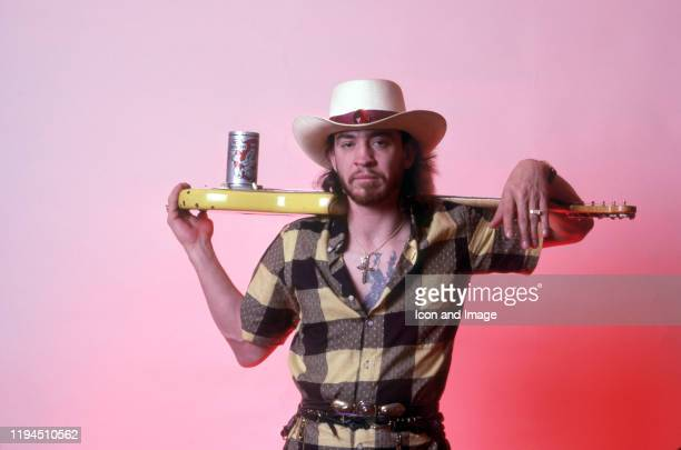 "American singer, songwriter and blues-rock guitar great, Stevie Ray Vaughan , poses backstage at the Meadow Brook Music Festival during his ""Soul to..."