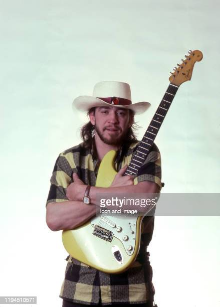 """American singer, songwriter and blues-rock guitar great, Stevie Ray Vaughan , poses backstage at the Meadow Brook Music Festival during his """"Soul to..."""