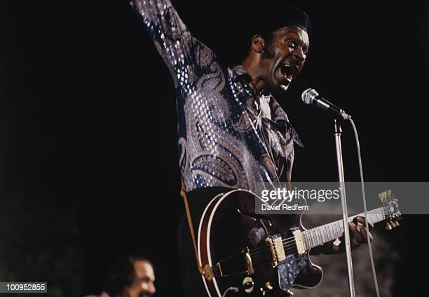 American singer and guitarist Chuck Berry performs on stage circa 1976