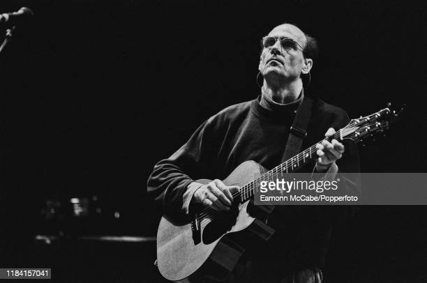 American singer songwriter and guitarist James Taylor plays an acoustic guitar at a soundcheck prior to a concert at the Hammersmith Apollo in London...
