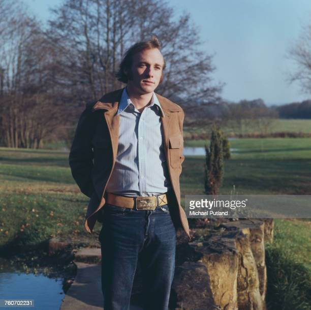 American singer songwriter and guitarist Stephen Stills of Crosby Stills and Nash and formerly of Buffalo Springfield posed beside a garden pond at...