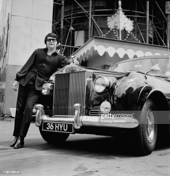 American singer songwriter and musician Roy Orbison with his RollsRoyce Silver Cloud at the London Festival Pleasure Gardens Battersea Park London UK...