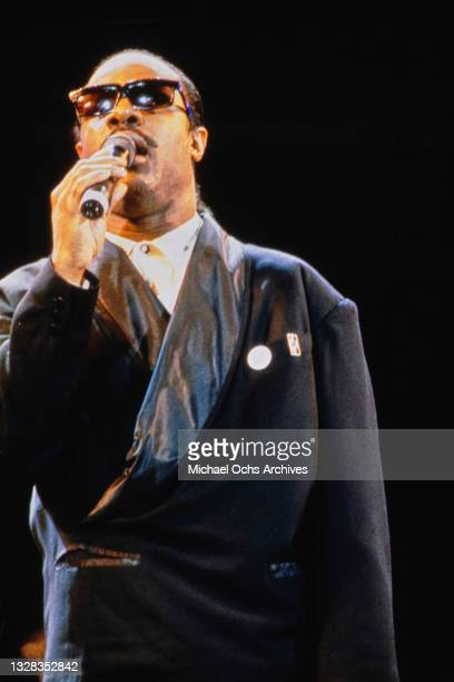 American singer, songwriter and musician Stevie Wonder performs at Wembley Stadium in London for the Nelson Mandela 70th Birthday Tribute Concert,...
