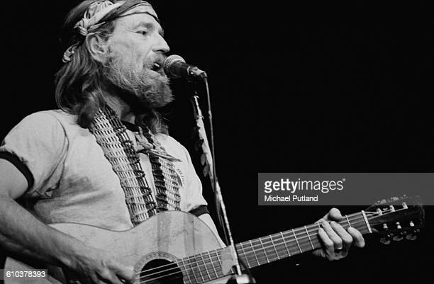 American singer, songwriter and musician Willie Nelson performing on stage, USA, April 1978.