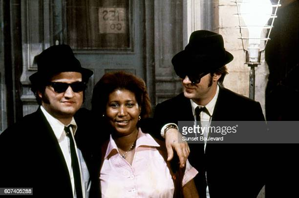 American singer songwriter and pianist Aretha Franklin surrounded by actor John Belushi and Canadian actor and screenwriter Dan Aykroyd on the set of...