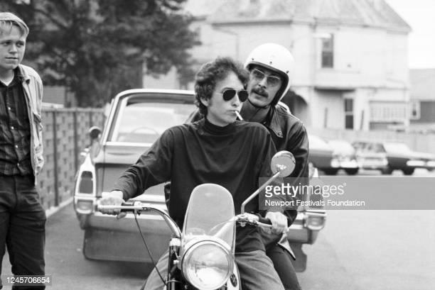 American singer songwriter Bob Dylan, sunglasses, cigarette, and old-timey folk musician Bob Siggins, white helmet, pillion, ride a motorcycle...