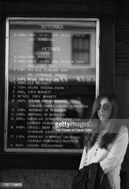 American singer songwriter Judee Sill poses for a portrait in front of the marquee for New York's Carnegie Hall where she will be performing that...