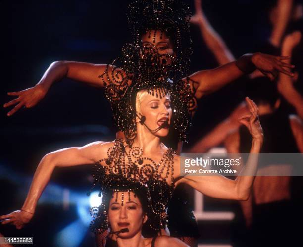 American singer songwriter Madonna performs live on stage during her 'Girlie Show Live Down Under' world concert tour at the Sydney Cricket Ground on...