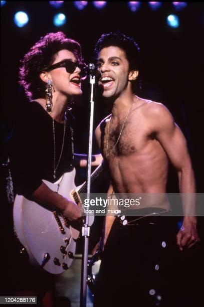 American singer, songwriter, musician, record producer, dancer, actor, and filmmaker Prince performs alongside Revolution guitarist Wendy Melvoin...