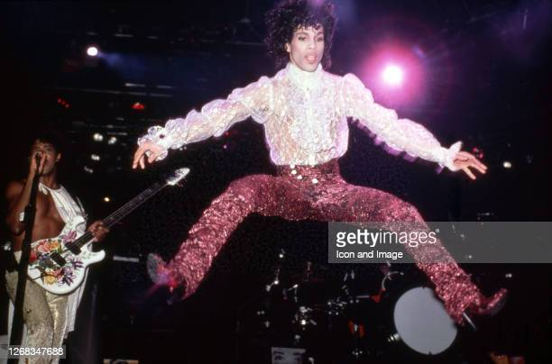 American singer, songwriter, musician, record producer, dancer, actor, and filmmaker Prince performs onstage during the 1984 Purple Rain Tour on...