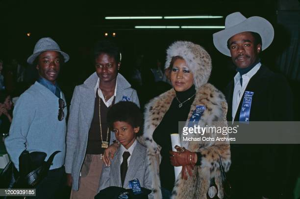 American singer, songwriter, pianist, and civil rights activist Aretha Franklin , wearing fur coat and hat, attends the Hollywood Christmas Parade...