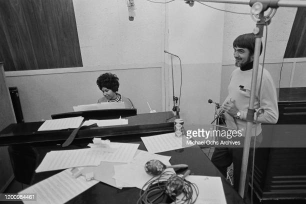 American singer, songwriter, pianist, and civil rights activist Aretha Franklin and American recording engineer and producer Tom Dowd during a...