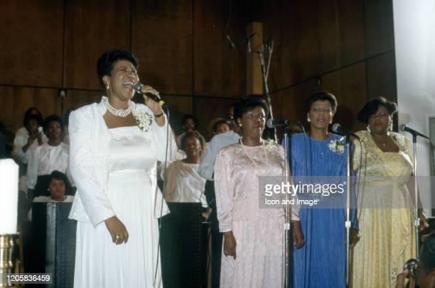 American singer, songwriter, pianist, and civil rights activist Aretha Franklin and her sisters Ema and Carolyn sing at the New Bethel Baptist Church...