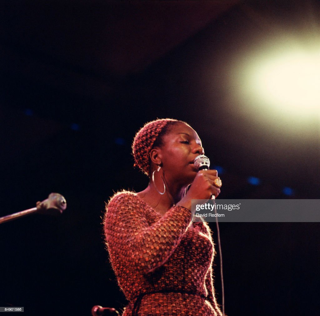 Photo of Nina SIMONE, Nina Simone performing on stage.