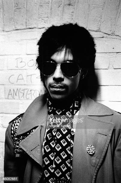American singer songwriter Prince poses wearing round sunglasses, Netherlands, 29th May 1981.