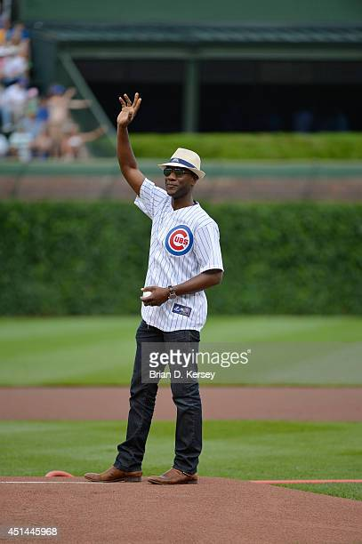 American singer songwriter rapper and musician Aloe Blacc throws out a ceremonial first pitch before the game between the Chicago Cubs and the...
