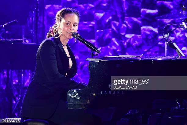 American singer songwriter record producer pianist Alicia Keys performs during the traditionnal Clive Davis party on the eve of the 60th Annual...
