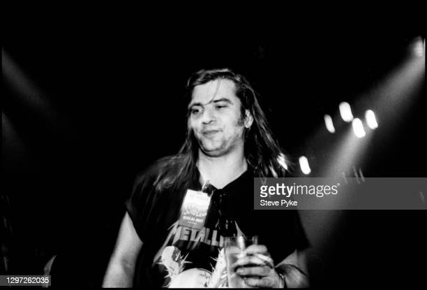 American singer songwriter, Steve Earle, performing with The Pogues at The Town and Country Club London March 1988.