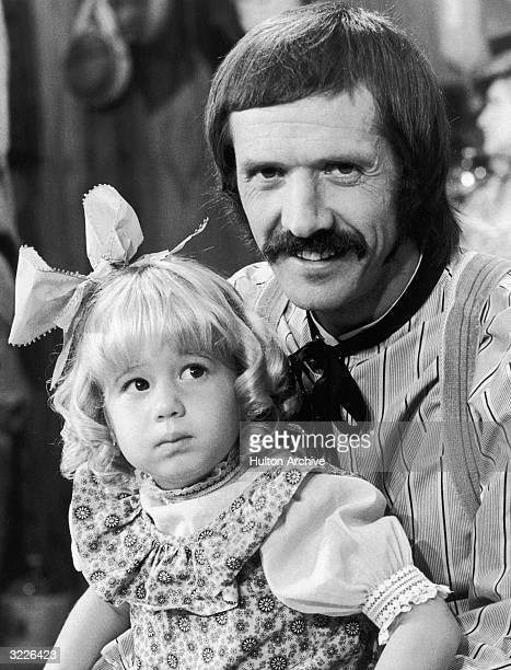 American singer Sonny Bono holding his young daughter Chastity on the set of television series 'The Sonny and Cher Comedy Hour'