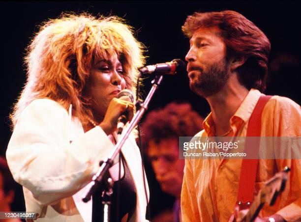 American singer Tina Turner and English musician Eric Clapton performing on stage together during the Prince's Trust 10th Anniversary Rock Gala at...