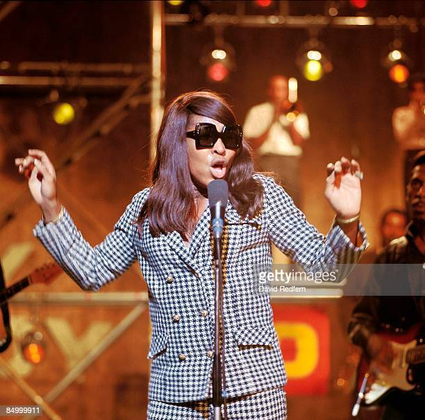 GO Photo of Ike Tina TURNER and Tina TURNER Ike Tina Turner with Ike Turner behind performing at Wembley Studios wearing sunglasses