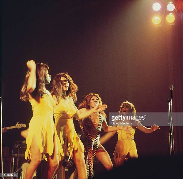 Singer Tina Turner of Ike and Tina Turner performs on stage with the Ikettes at the Hammersmith Odeon in London England in October 1975